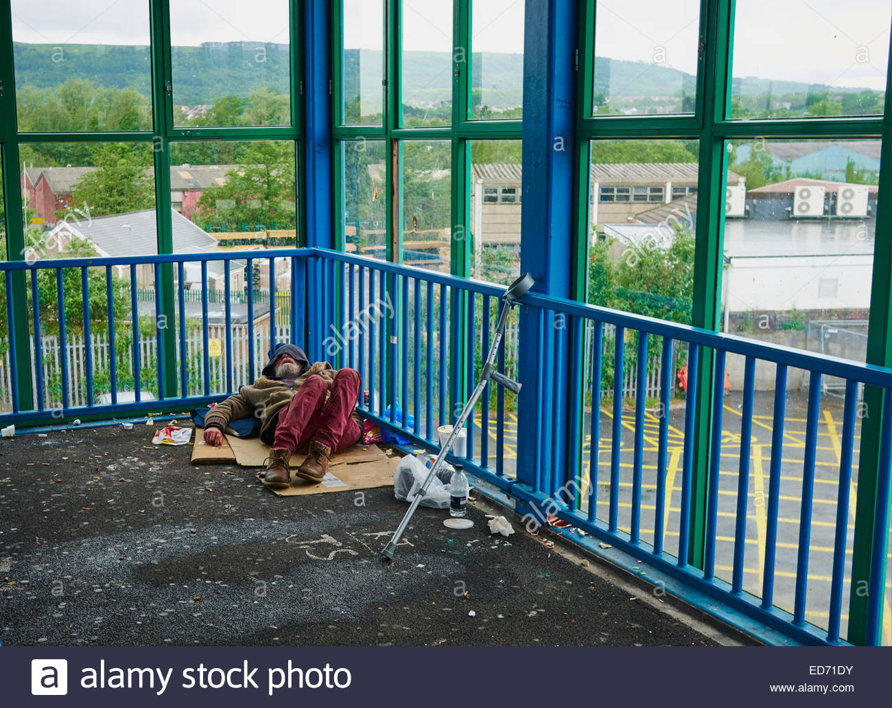 homeless tramp person sleeping rough in neath town centre south wales uk - Stock Image
