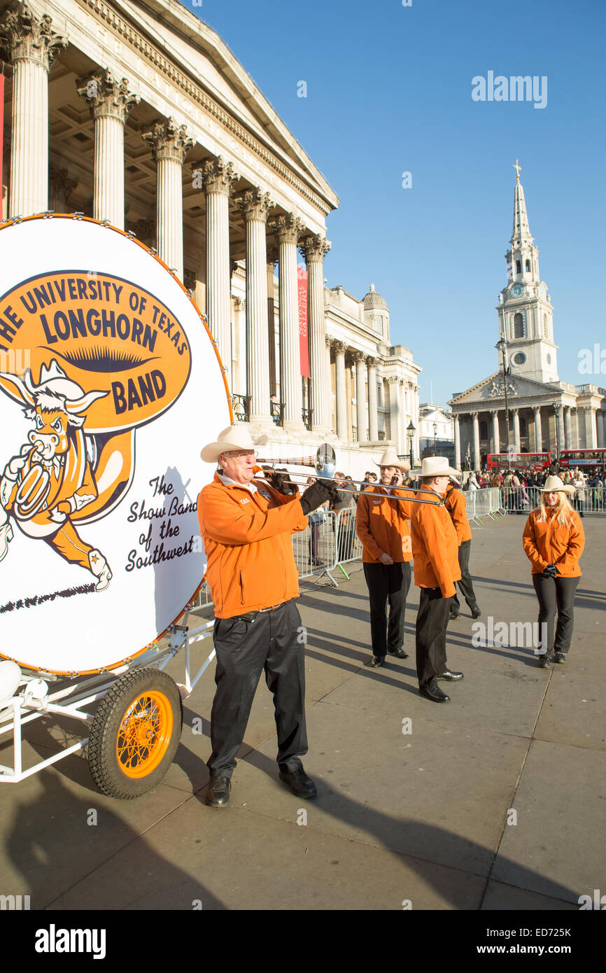 Trafalgar Square, London, UK.  30th December 2014.  The University of Texas Longhorn Alumni Band with their 8 ft - Stock Image