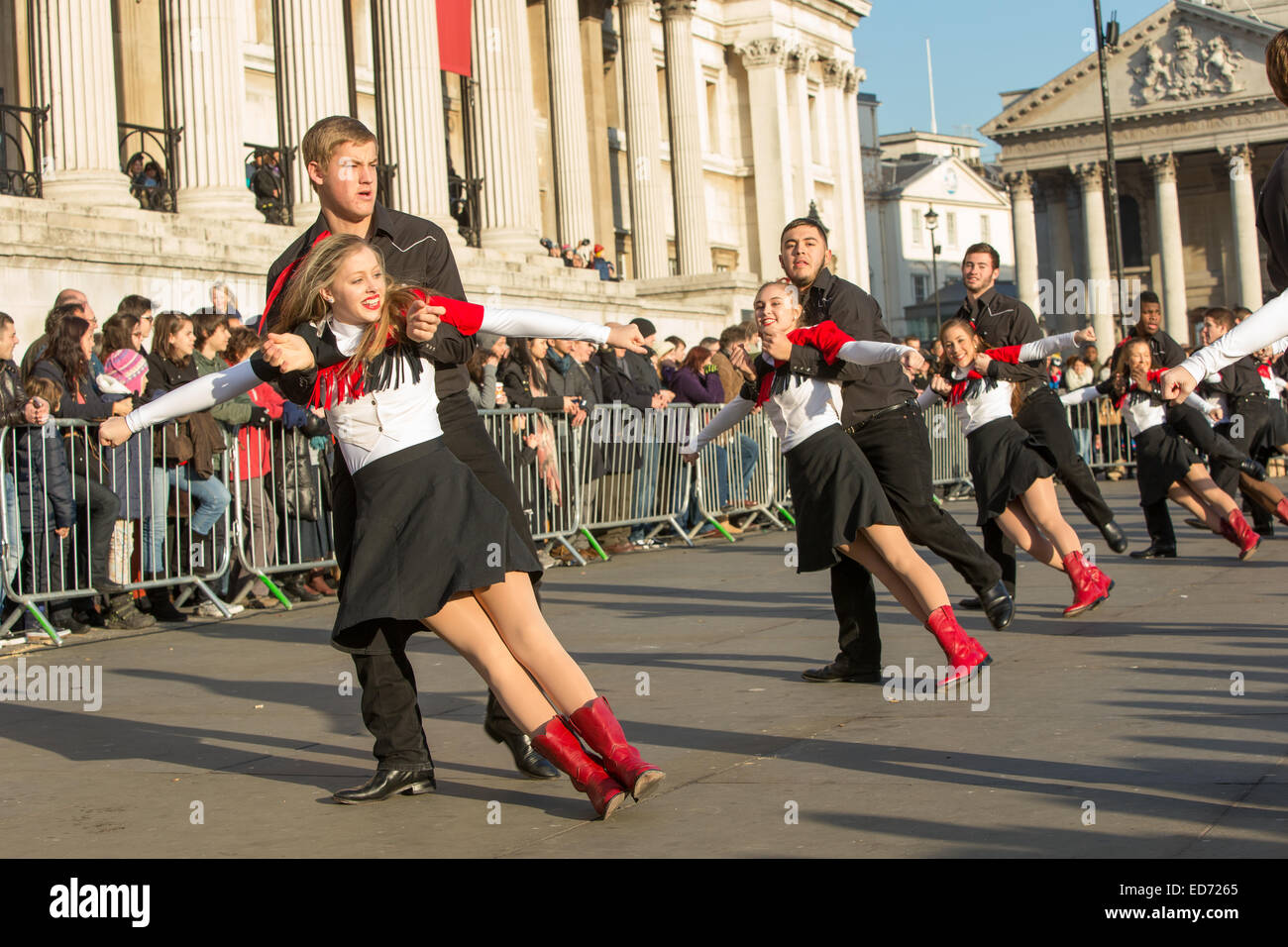 Trafalgar Square, London, UK.  30th December 2014.  The Lake Highlands Wildcat Wranglers dance troupe, from Texas, - Stock Image