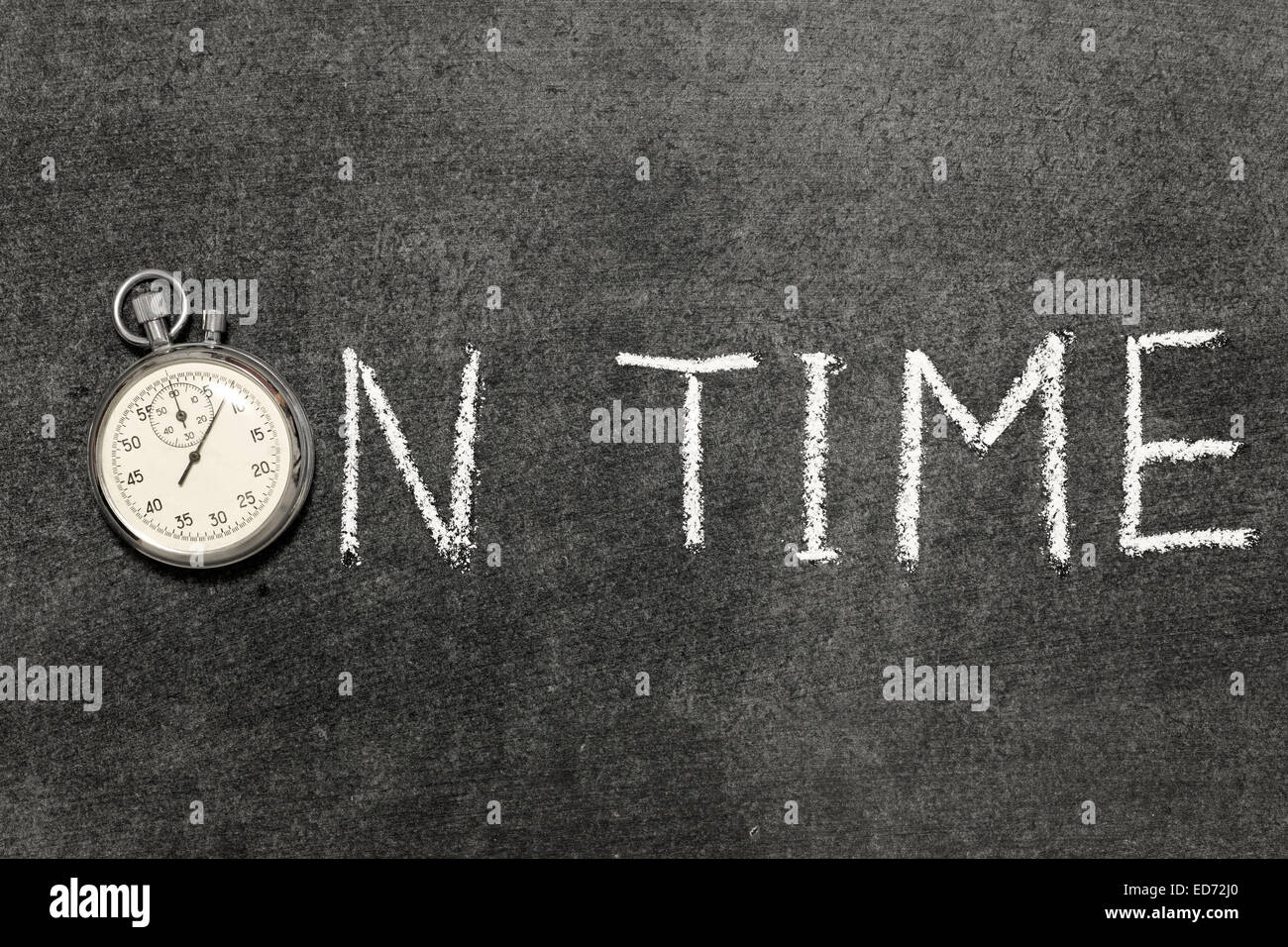 on time phrase handwritten on chalkboard with vintage precise stopwatch used instead of O - Stock Image