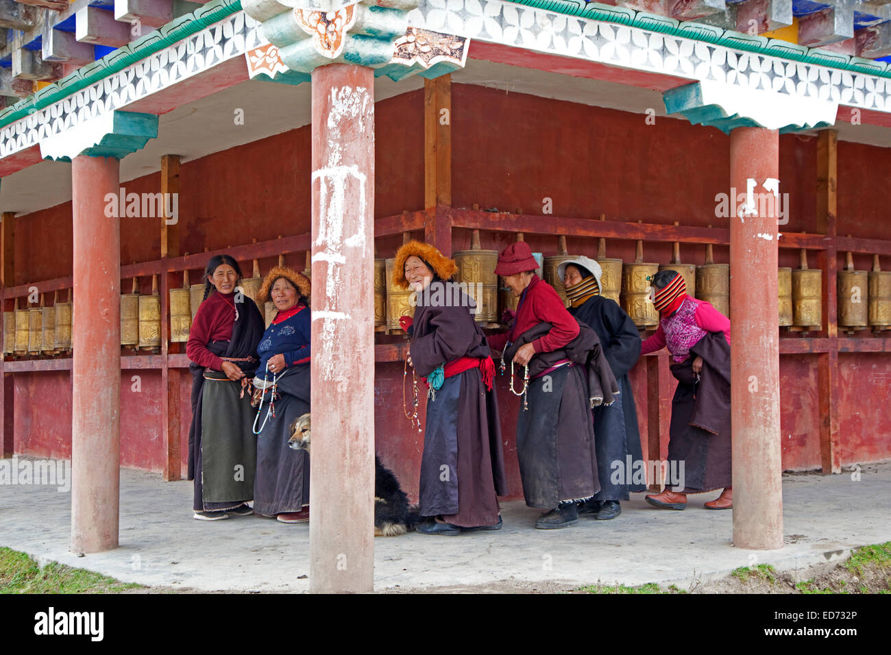 Tibetan women turning prayer wheels in the village Zhuqing, Sichuan Province, China - Stock Image