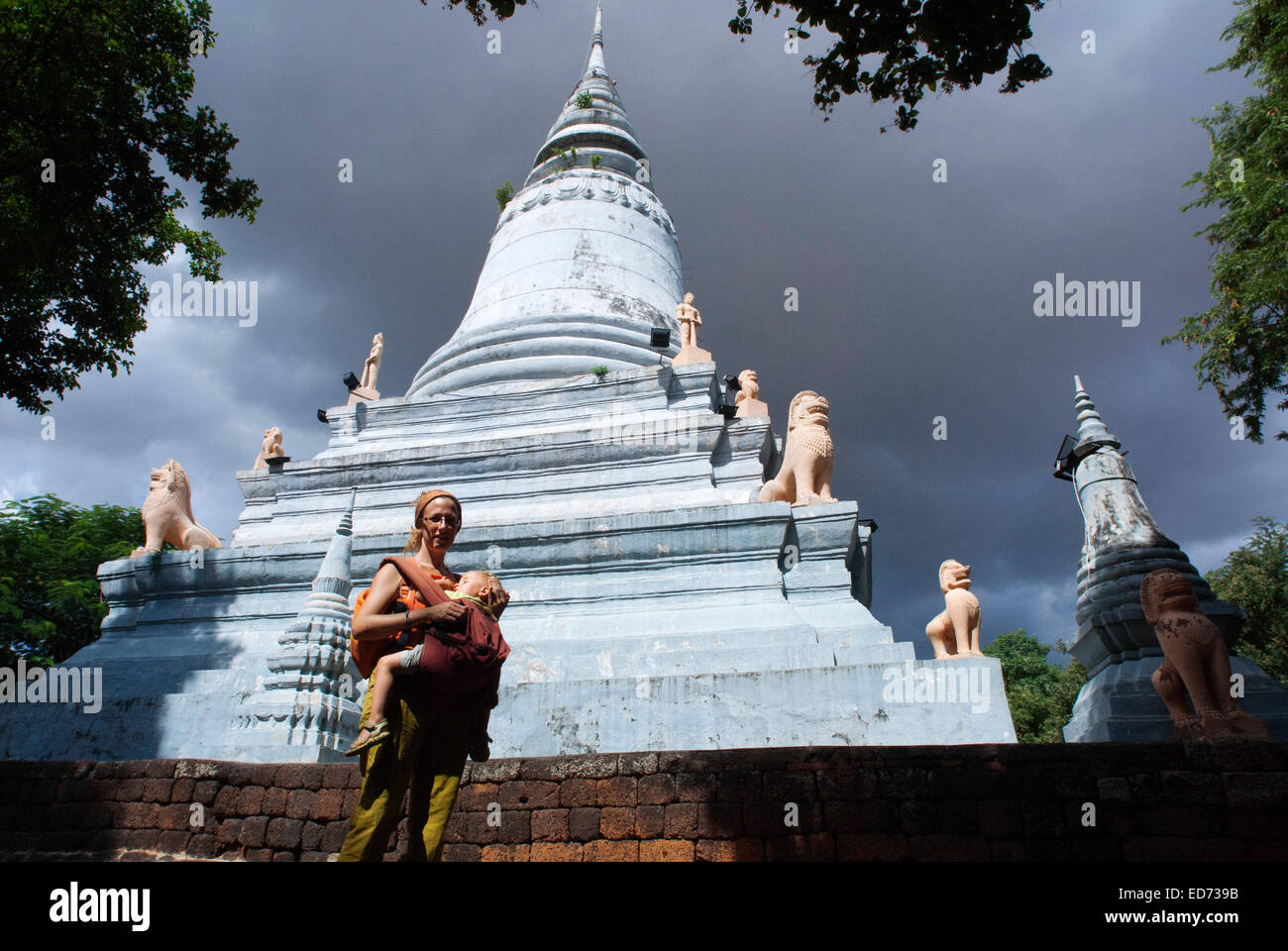 Wat Phnom, Phnom Penh, Cambodia. Travel with children's. Mother traveling with her daughter. Wat Phnom is a Buddhist - Stock Image