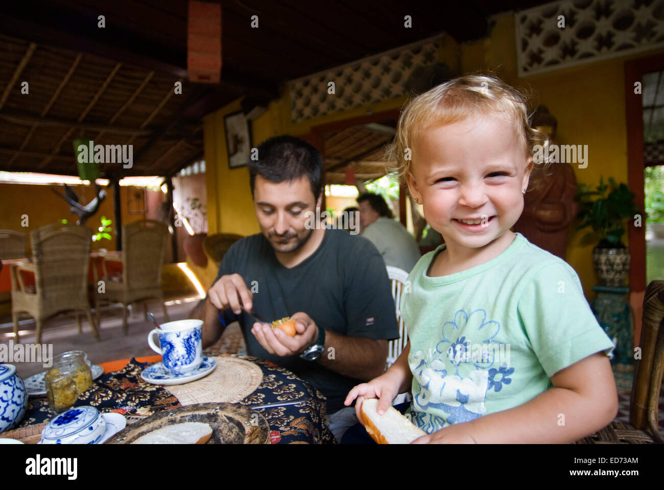 Breakfast in the Hotel. Cambodia. Travel with children's.  Father traveling with her daughter.  Secrets of Elephants - Stock Image