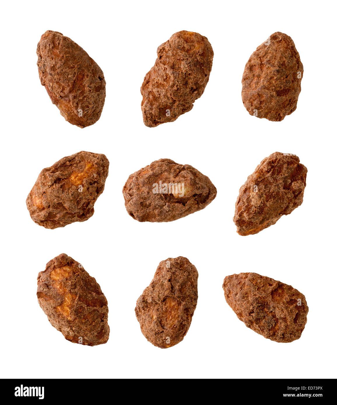 Nine Chocolate Coated Almonds. - Stock Image