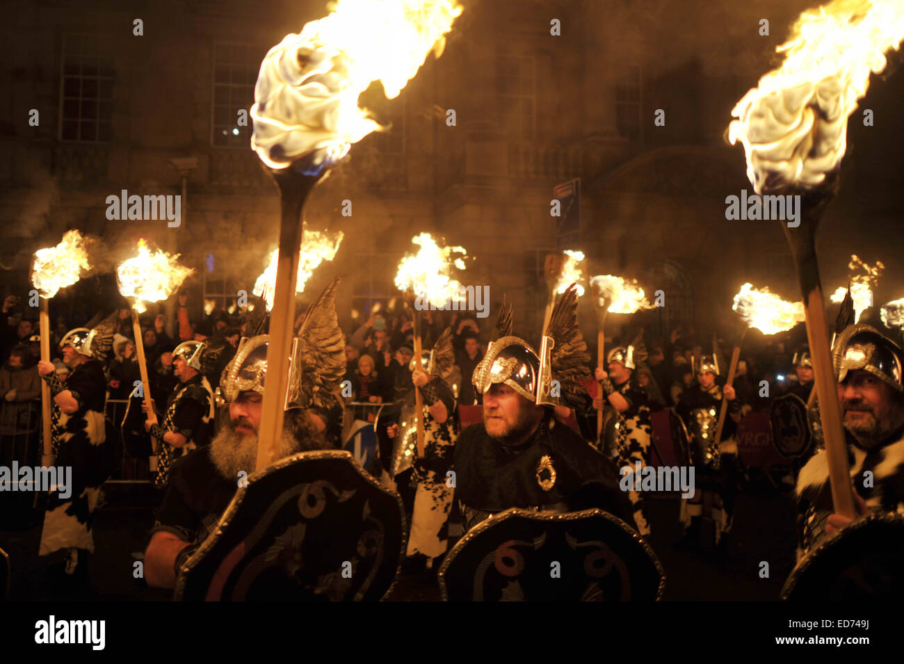 Edinburgh, UK. 30th December 2014. Thousands gather in the center of Edinburgh for the Hogmany Torchlight Procession - Stock Image