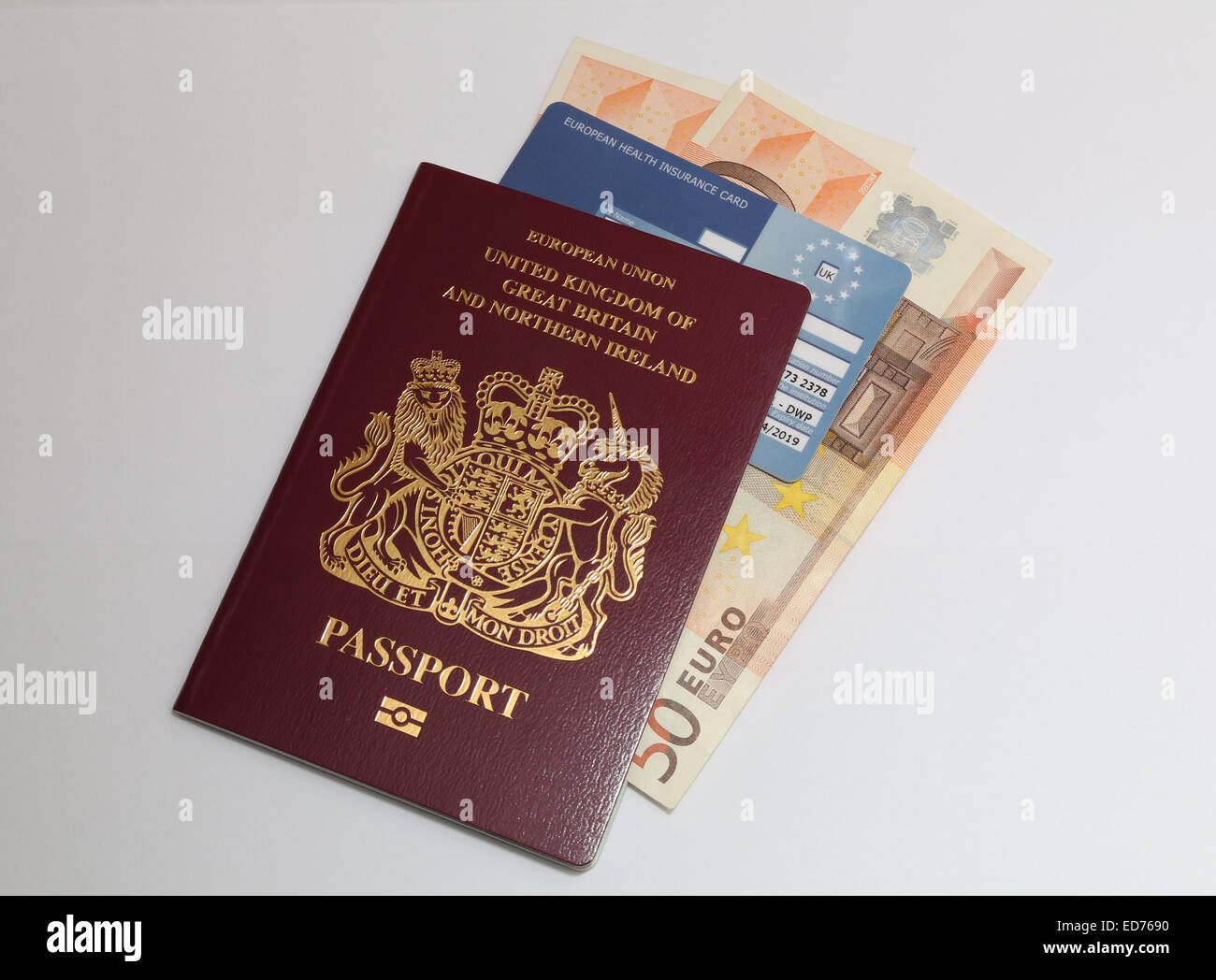 UK passport, euro currency and eu health card.  Concept travel documents required for travel in Europe. - Stock Image