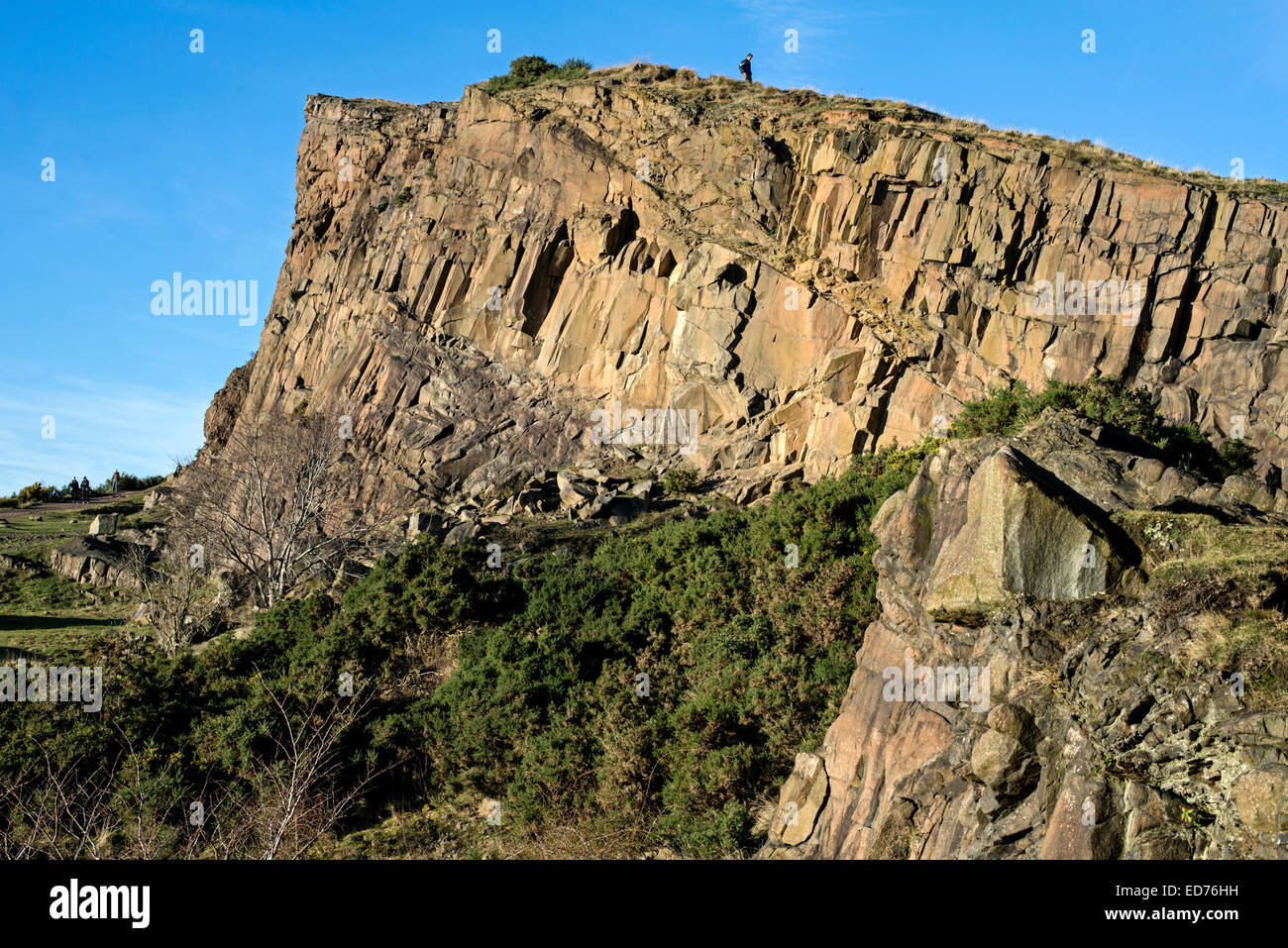 A view of Salisbury Crags from the Radical Road in Edinburgh's Holyrood Park. - Stock Image
