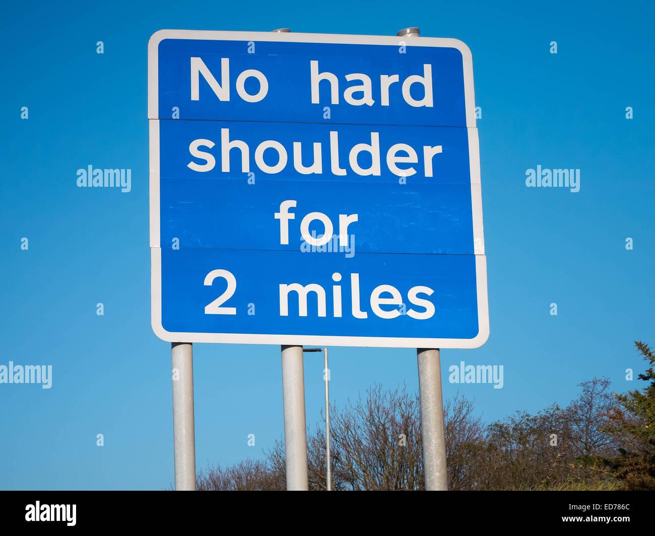 Motorway sign declaring 'No hard shoulder for 2 miles' - Stock Image