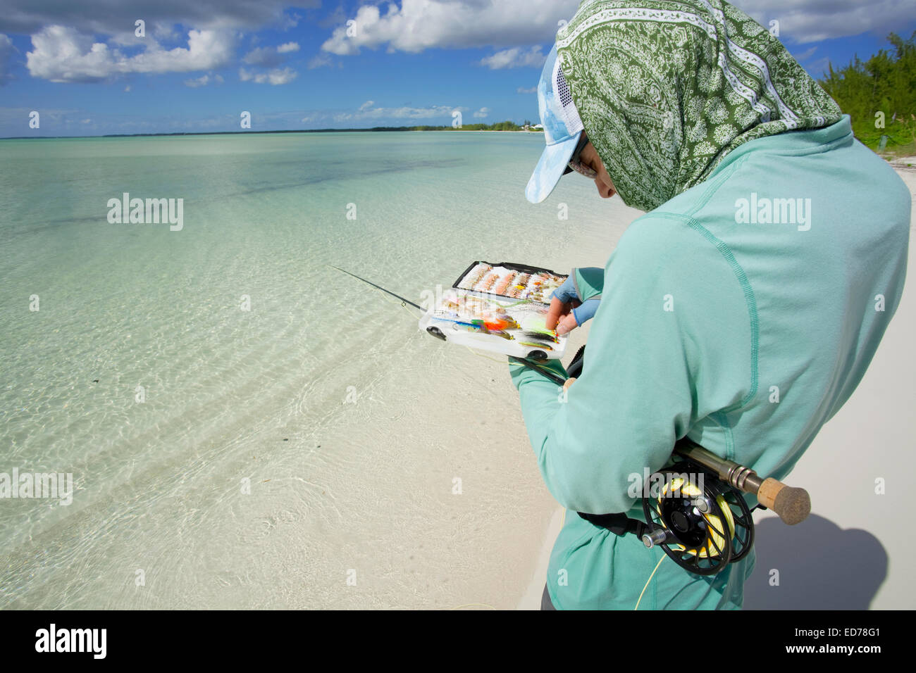 Man saltwater fly fishing for bonefish in Abaco, Bahamas - Stock Image