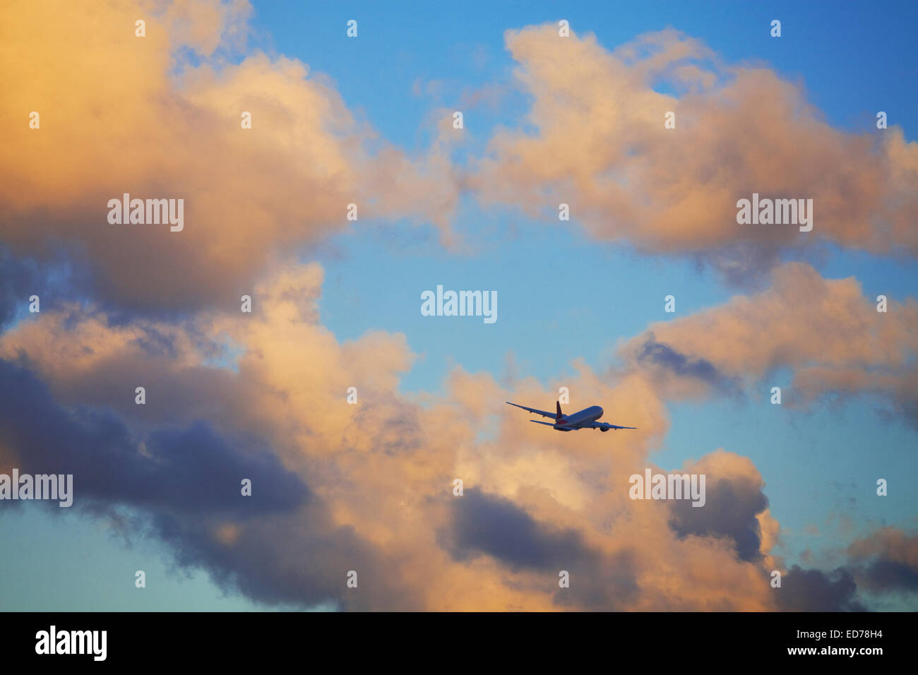Commercial airliner in flight near Miami, Florida, USA - Stock Image