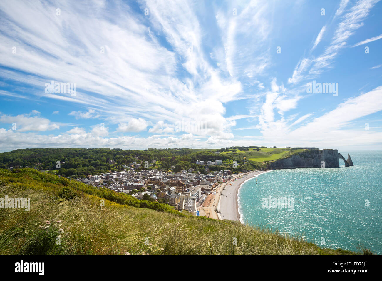 Etretat village, its bay beach and Aval cliff landmark. Aerial view. Normandy, France - Stock Image