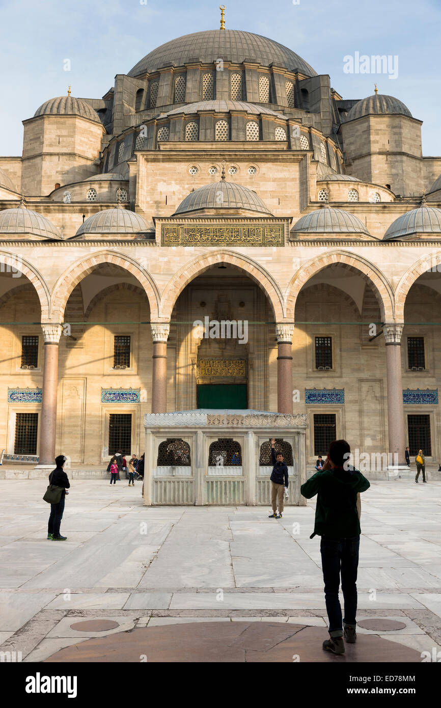Tourists taking photographs in collonaded courtyard of Suleymaniye Mosque in Istanbul, Republic of Turkey Stock Photo