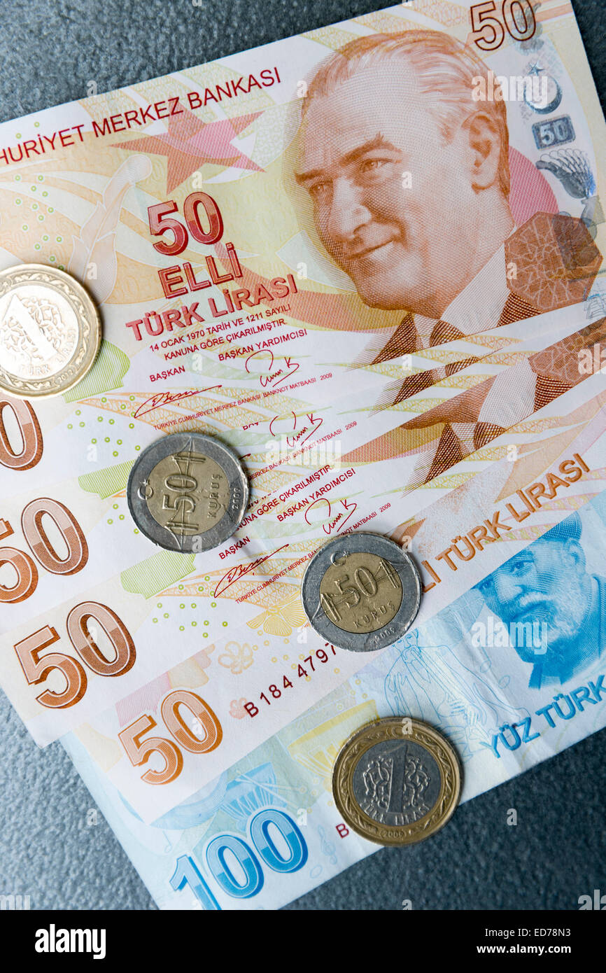 Turkish lira - Turk Lirasi - local currency coins and banknotes, featuring image of Ataturk, in Republic of Turkey Stock Photo
