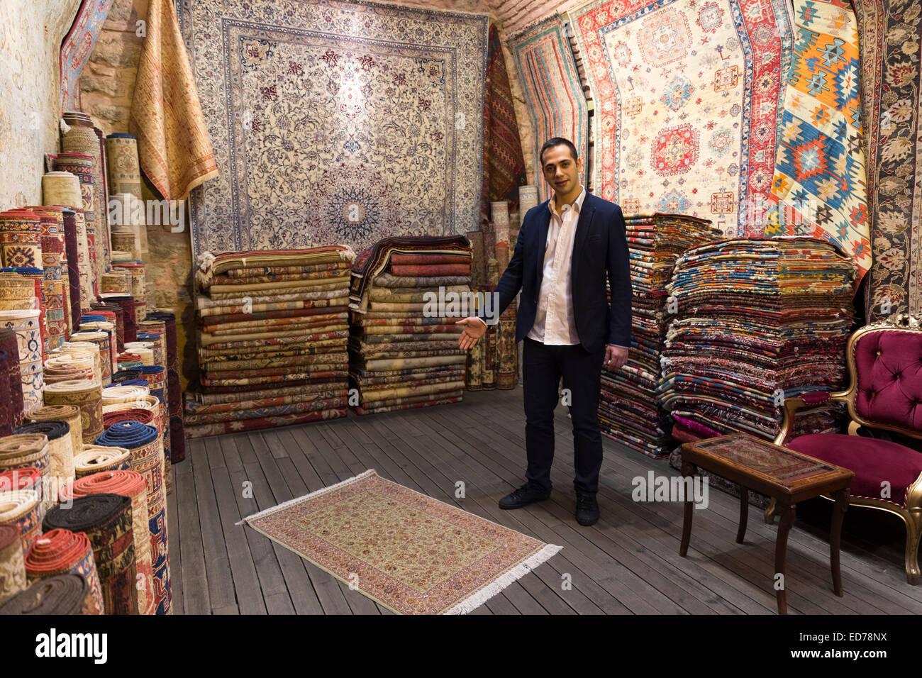 Salesman With Traditional Turkish Carpet Rug In The Grand Bazaar Kapalicarsi Great Market Beyazi Istanbul Republic Of Turke
