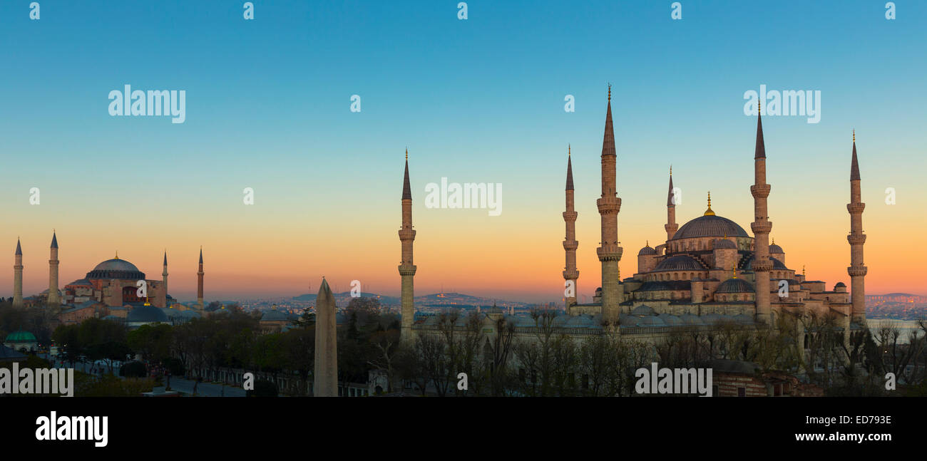 Sunset at The Blue Mosque, Sultanahmet Camii or Sultan Ahmed, and Hagia Sophia mosque museum in Istanbul, Turkey - Stock Image