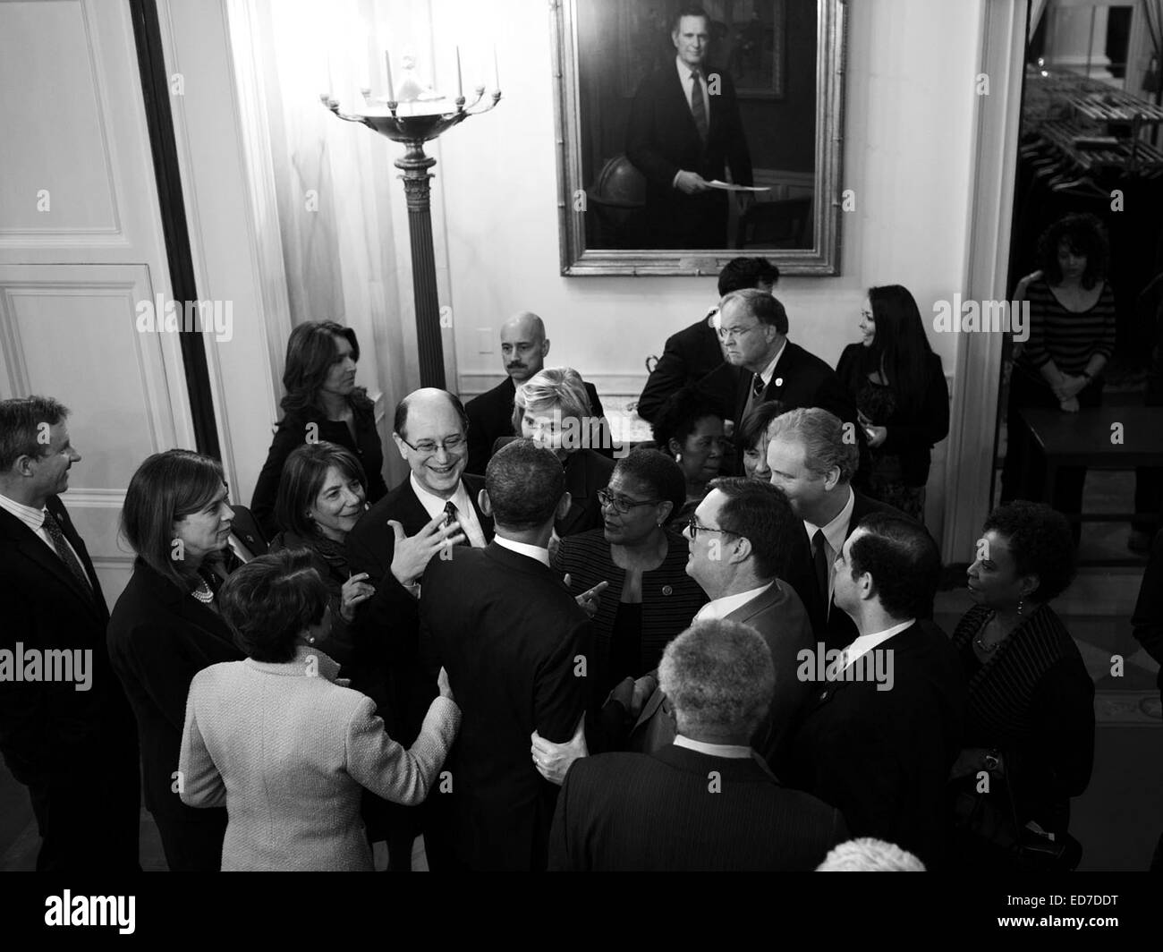 Members of Congress surround US President Barack Obama following a meeting with the House Democratic Caucus in the - Stock Image