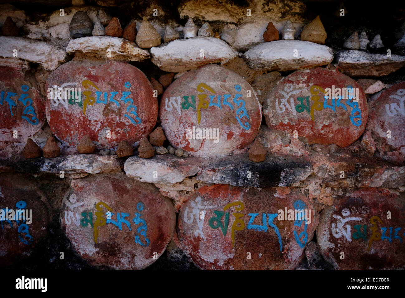 'Om mani padme' Tibetan mantra inscription on stone in front of the Buddhist Kurjey Lhakhang monastery which - Stock Image
