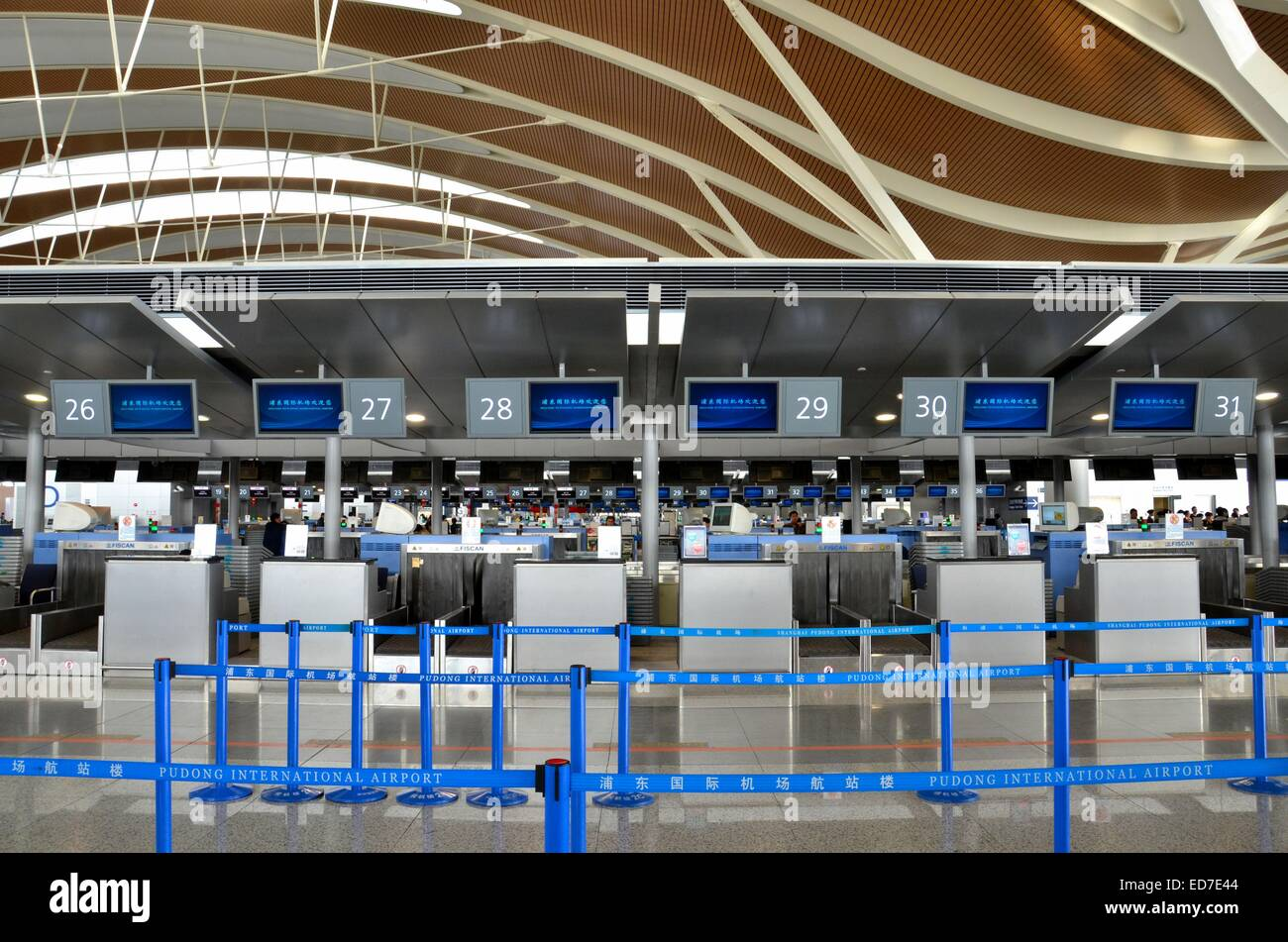Empty check in counters at Shanghai Pudong International Airport China - Stock Image