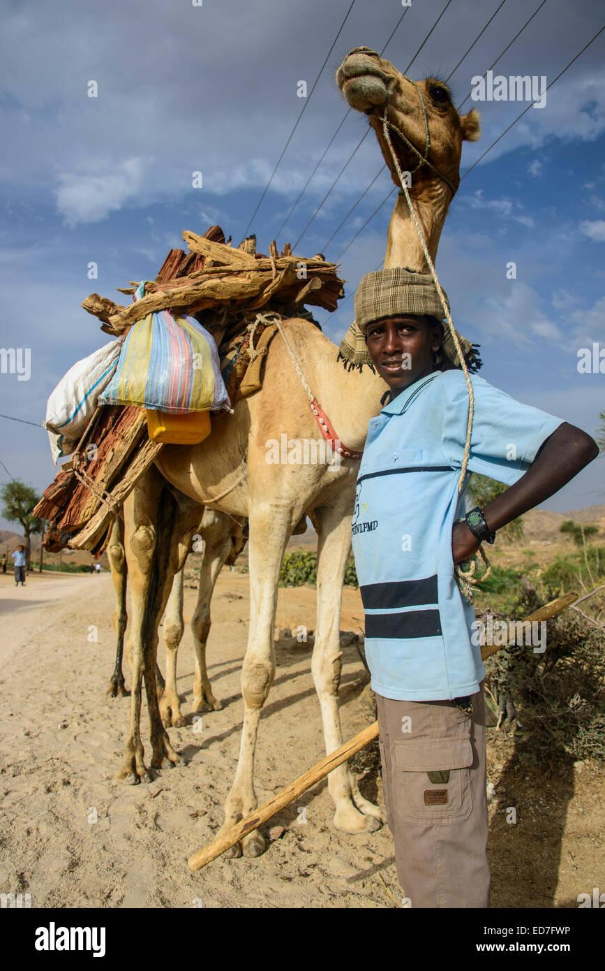 Proud boy posing with his camel, Keren, Eritrea - Stock Image