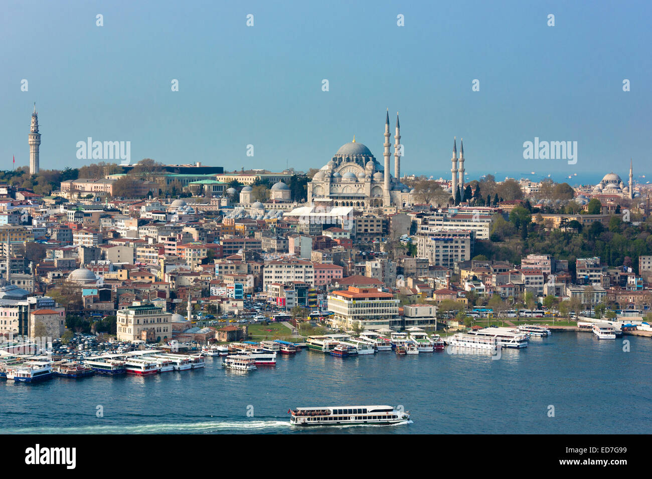 Skyline cityscape and the Blue Mosque and passenger ferry boat  on Bosphorus River in Istanbul, Republic of Turkey - Stock Image