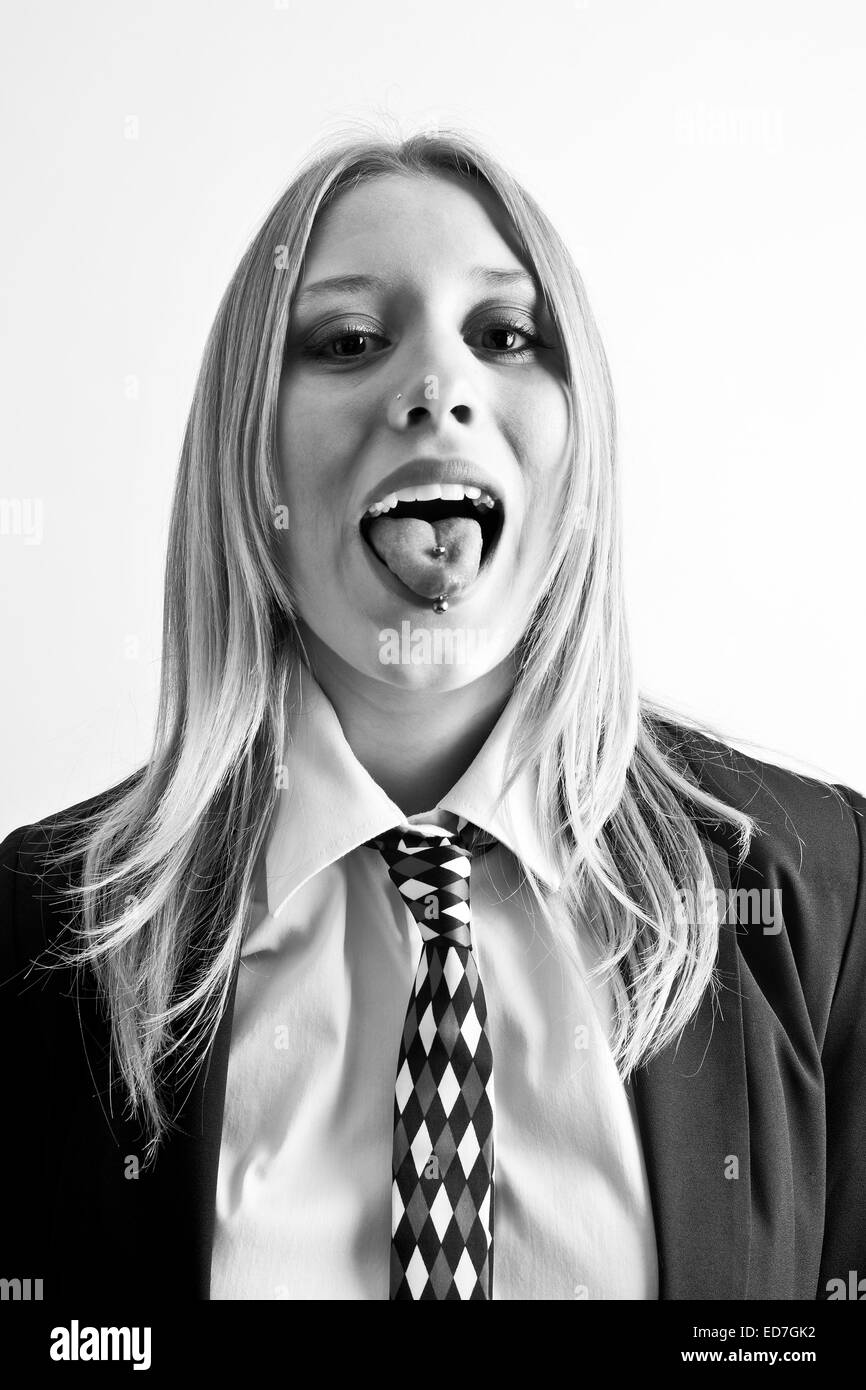 Woman with tongue piercing - Stock Image