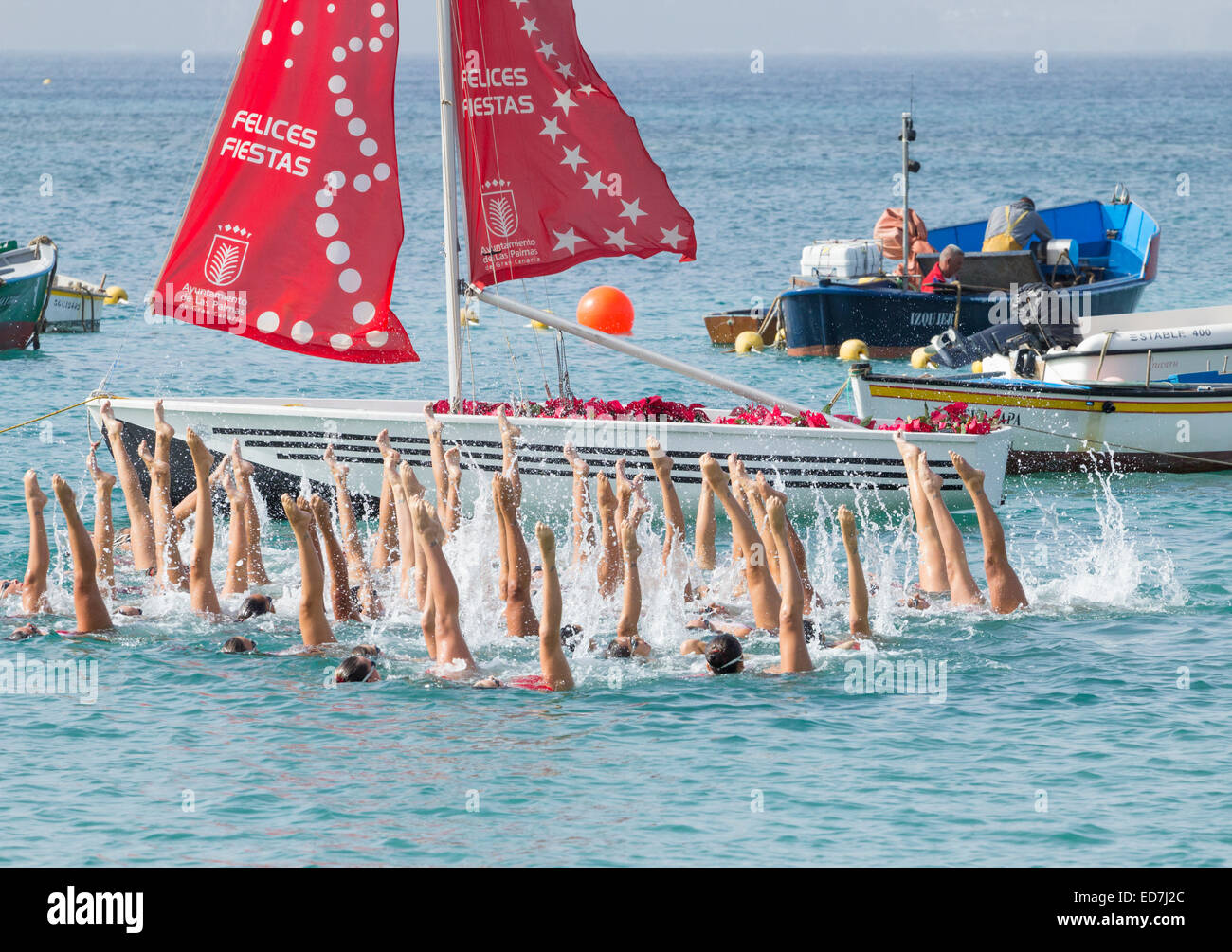 Synchronized swimmers giving demonstration - Stock Image