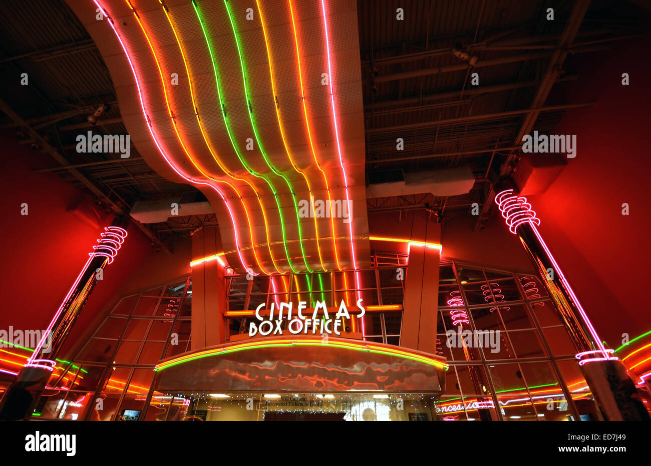 Neon lights at movie theater entrance and box office - Stock Image