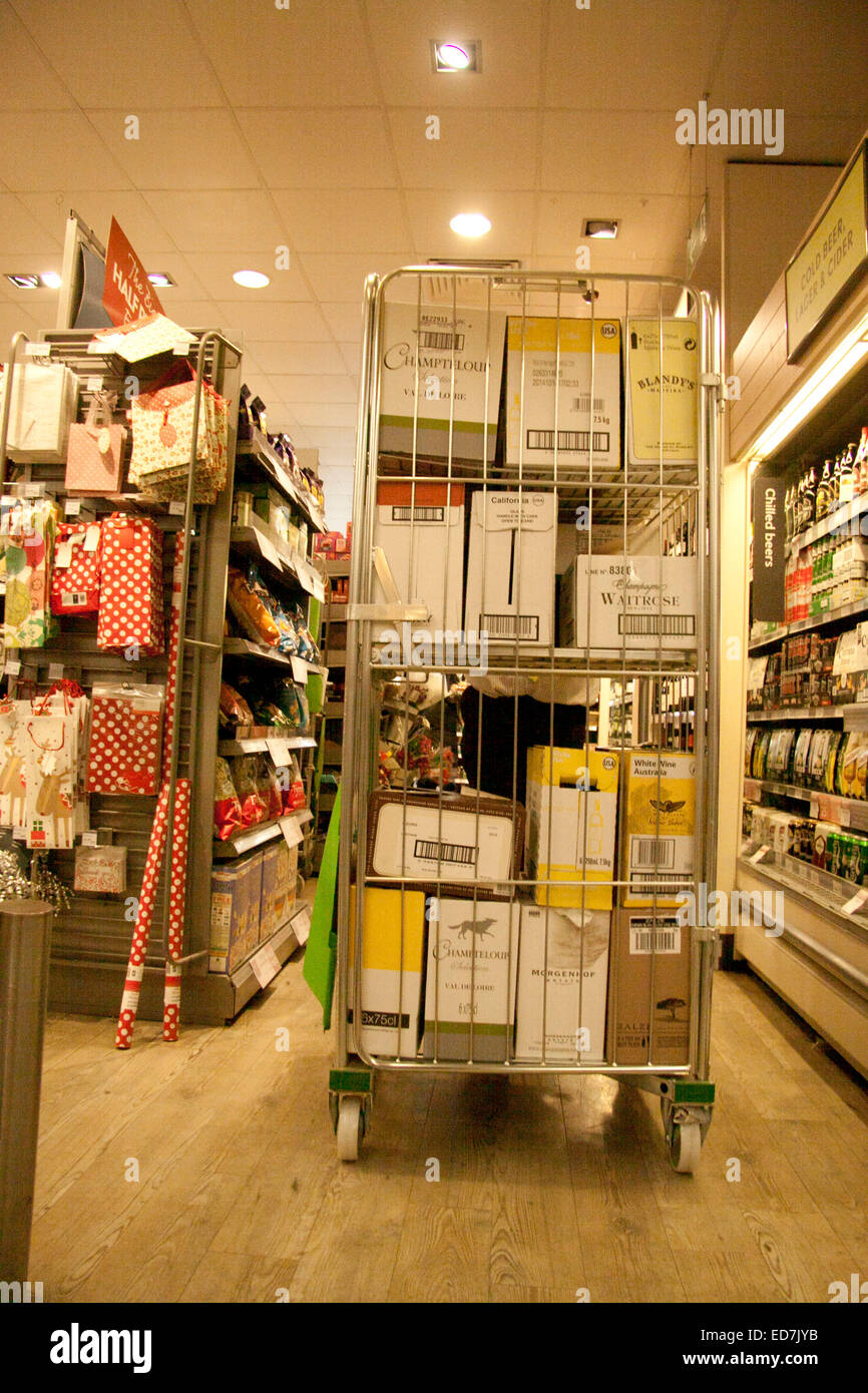 Wimbledon London,UK. 31st December 2014. A trolley with crates of alcohol  as supermarkets shelves are stocked with - Stock Image