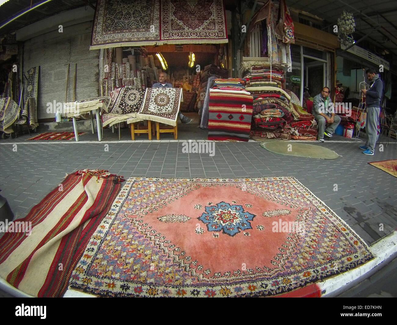 Carpets for sale at the Jaffa Flea Market, Jaffa, Israel. - Stock Image