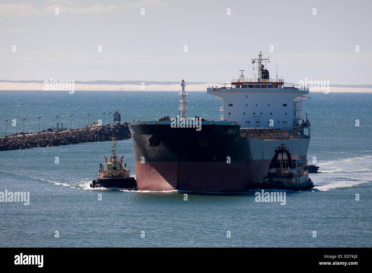 Bulk Carrier Hai Ji entering the Hunter River to load coal at Newcastle NSW Australia - Stock Image