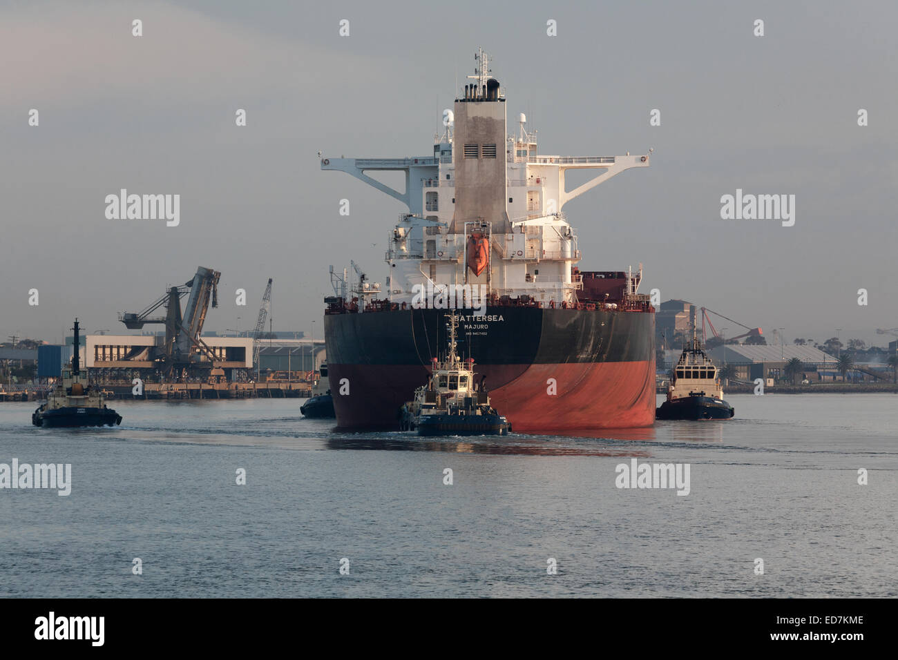 Empty bulkcarrier arriving to load export coal from Hunter Valley mines Newcastle Australia  with the assistance - Stock Image