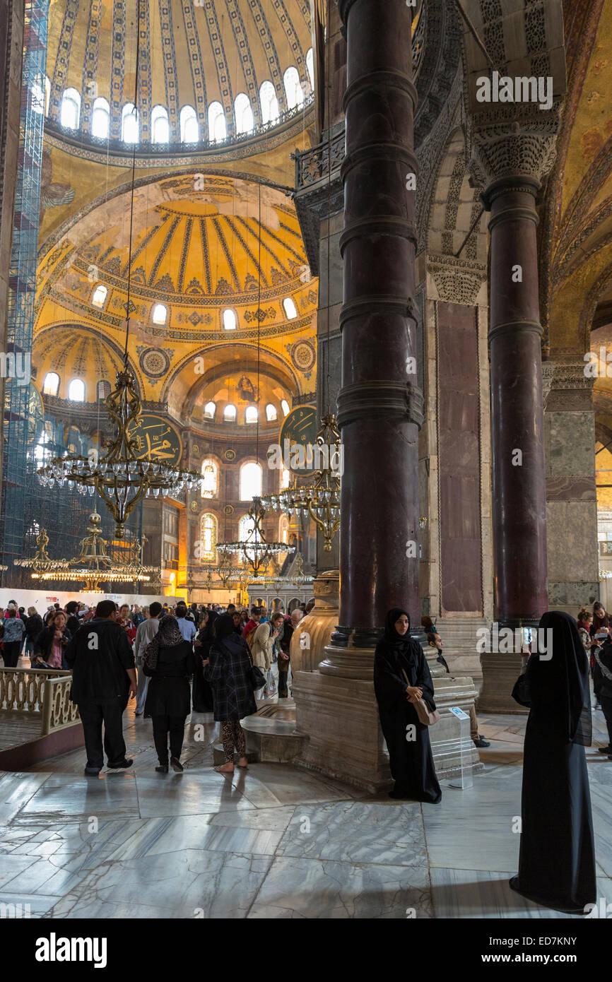 Muslim women at Hagia Sophia Ayasofya Muzesi mosque museum in niquab using smartphone to take photograph Istanbul, - Stock Image