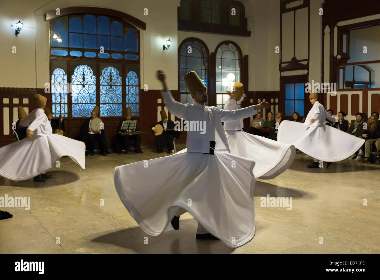 Tourists at Whirling Dervish ayin music performance - Mevlevi Sema - ceremony (whirling dervishes), Istanbul, Republic - Stock Image