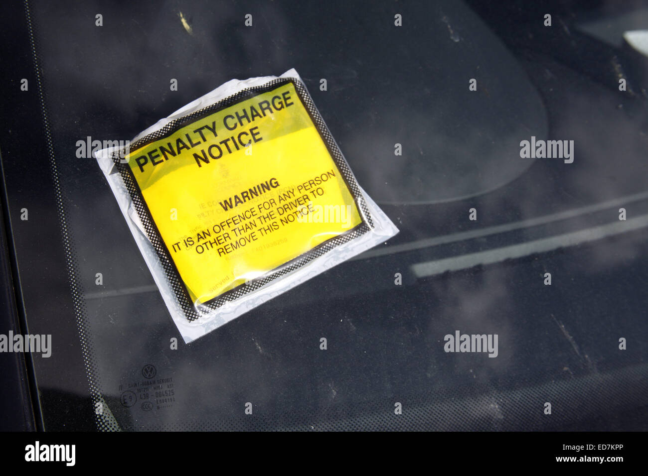 Penalty Charge Notice fixed to car windscreen. - Stock Image