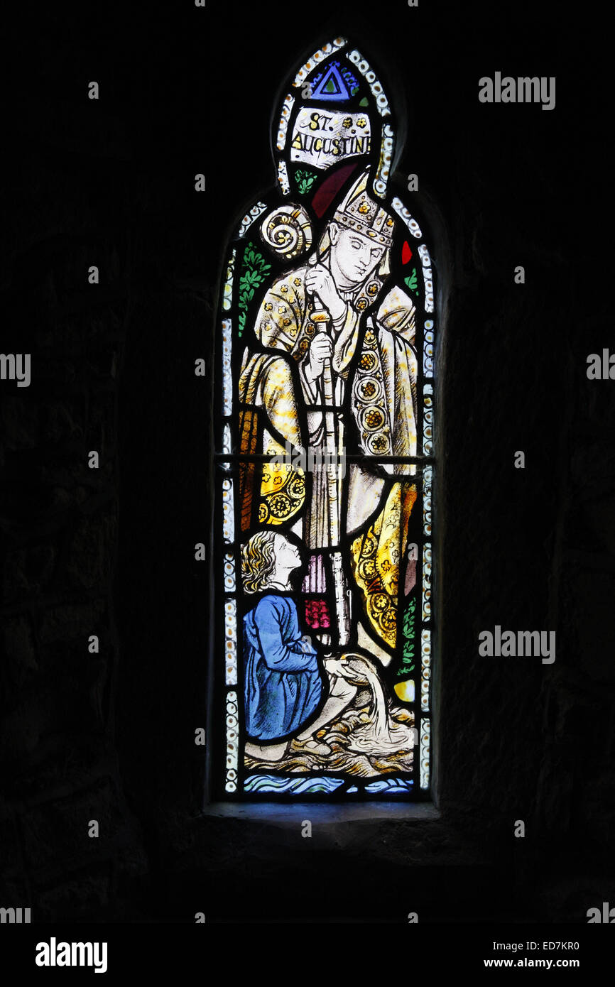 A stained glass window depicting St Augustine, St Thomas a Becket Church, Huntington, Powys, Wales - Stock Image