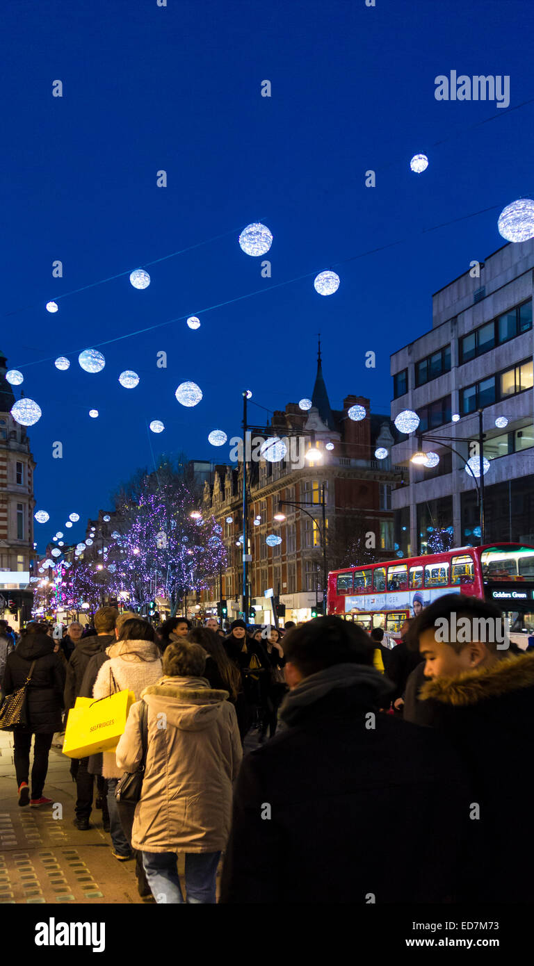 Shoppers in Oxford Street, Christmas Eve. - Stock Image