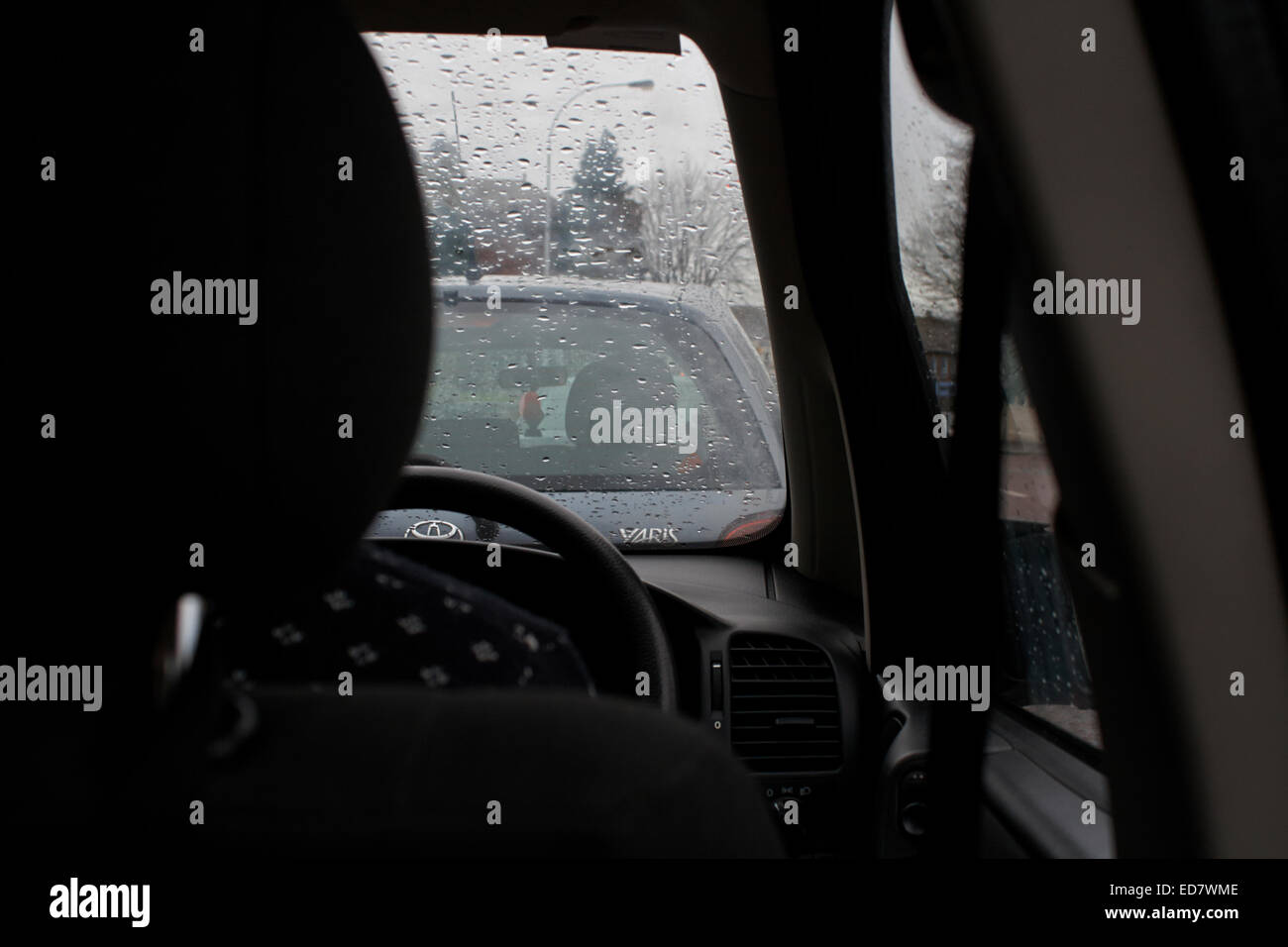 sitting in the back seat of a car on the morning wet school run in the uk - Stock Image