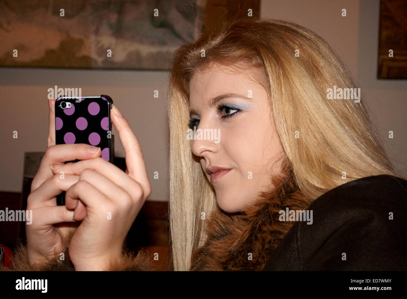 teenage girl taking photos with her cellphone - Stock Image