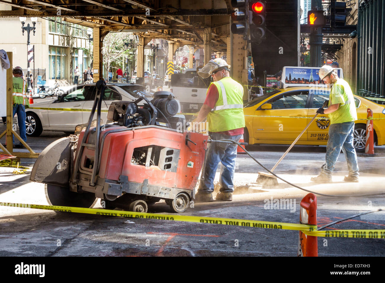 Chicago Illinois Loop downtown North State Street road construction repair capital improvements man working job - Stock Image