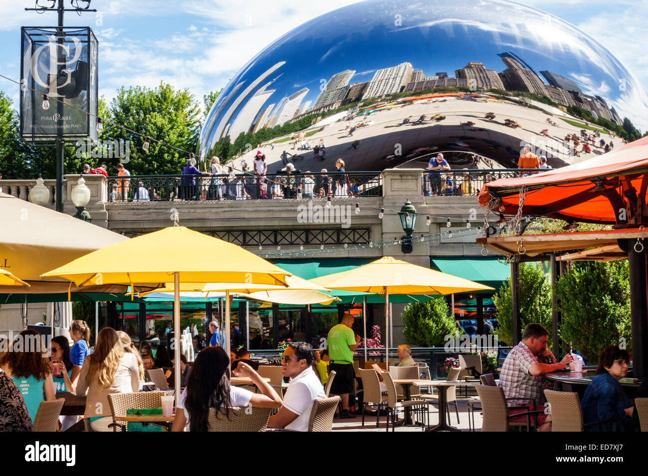 Chicago Illinois Loop Millennium Park Park Grill restaurant alfresco dining outdoor umbrellas yellow Cloud Gate - Stock Image