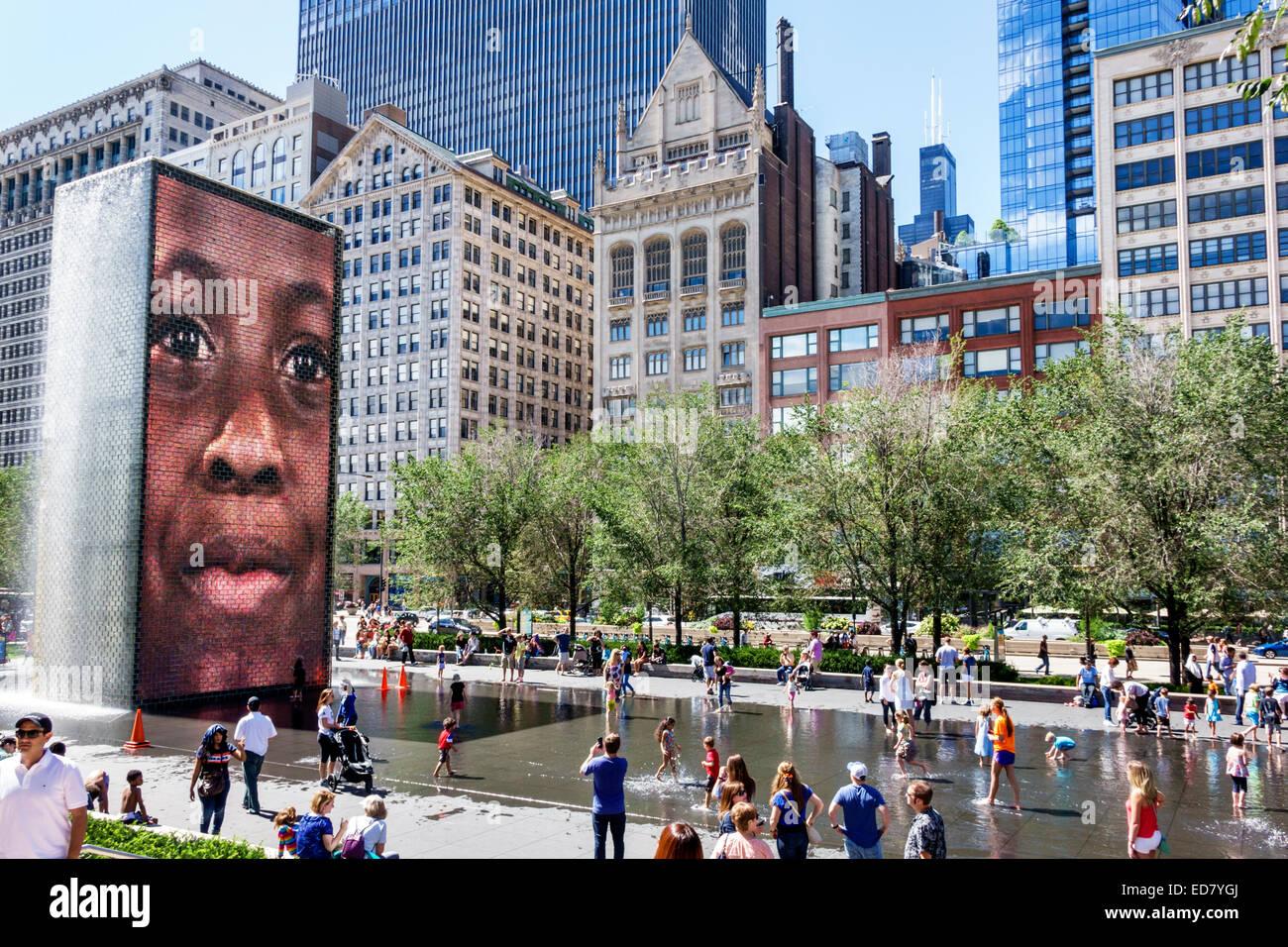 Chicago Illinois Loop Millennium Park Crown Fountain reflecting pool North Michigan Avenue city skyline skyscrapers - Stock Image
