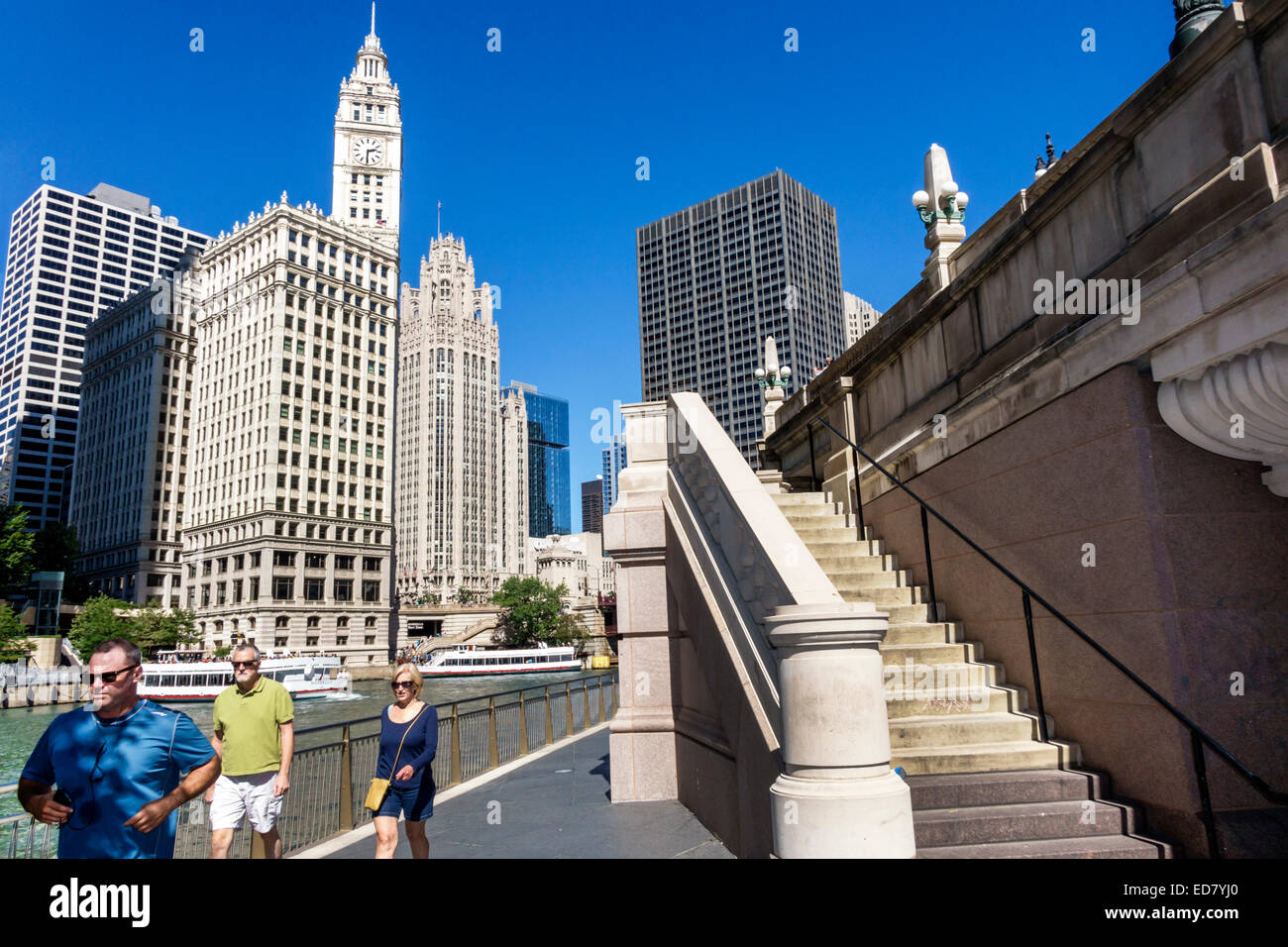 Chicago Illinois Chicago River downtown Wrigley Building city skyline skyscrapers Riverwalk residents walking - Stock Image