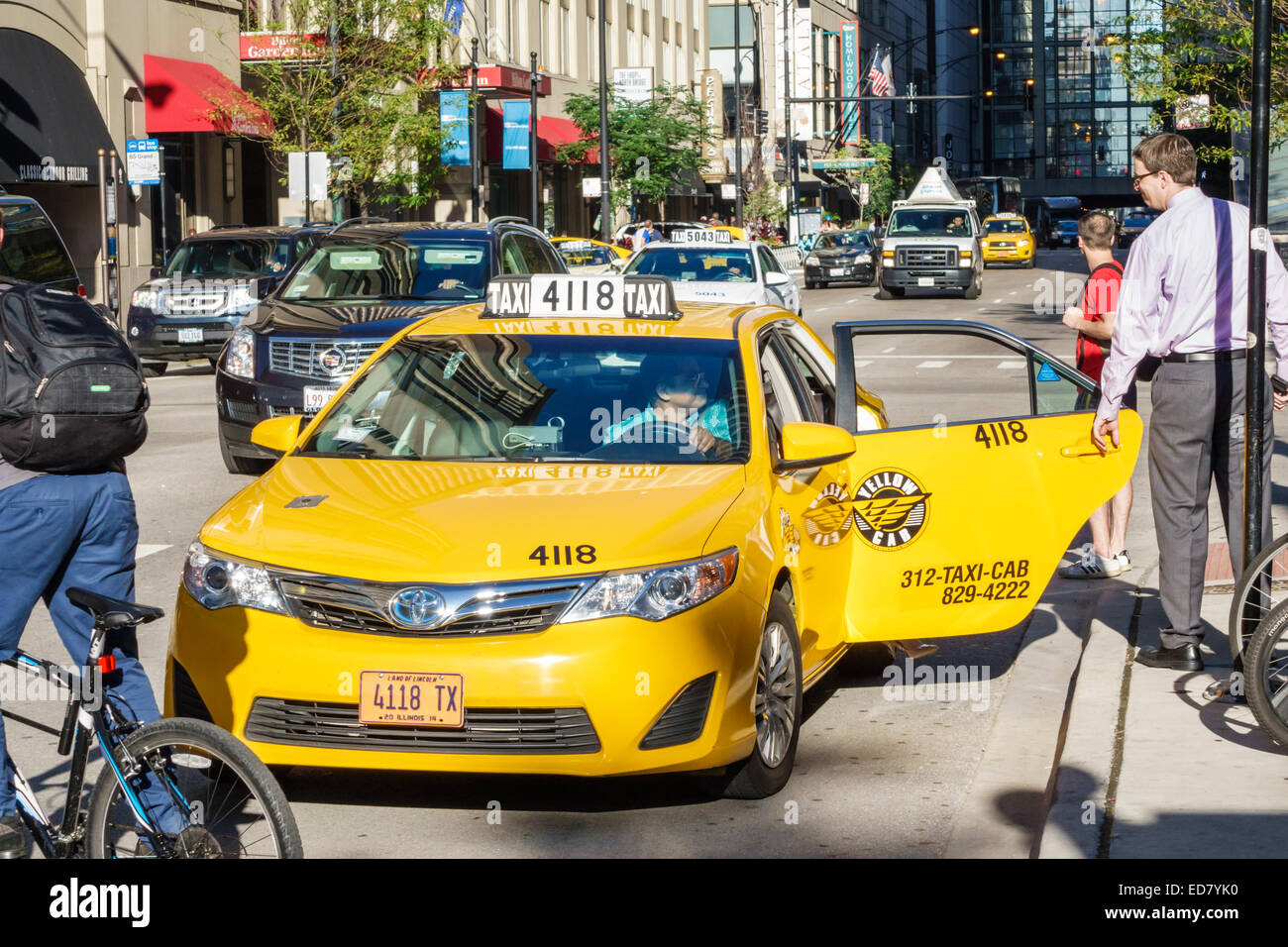 Chicago Illinois River North downtown South State Street East Grand Avenue traffic yellow taxi cab taxis cabs Stock Photo