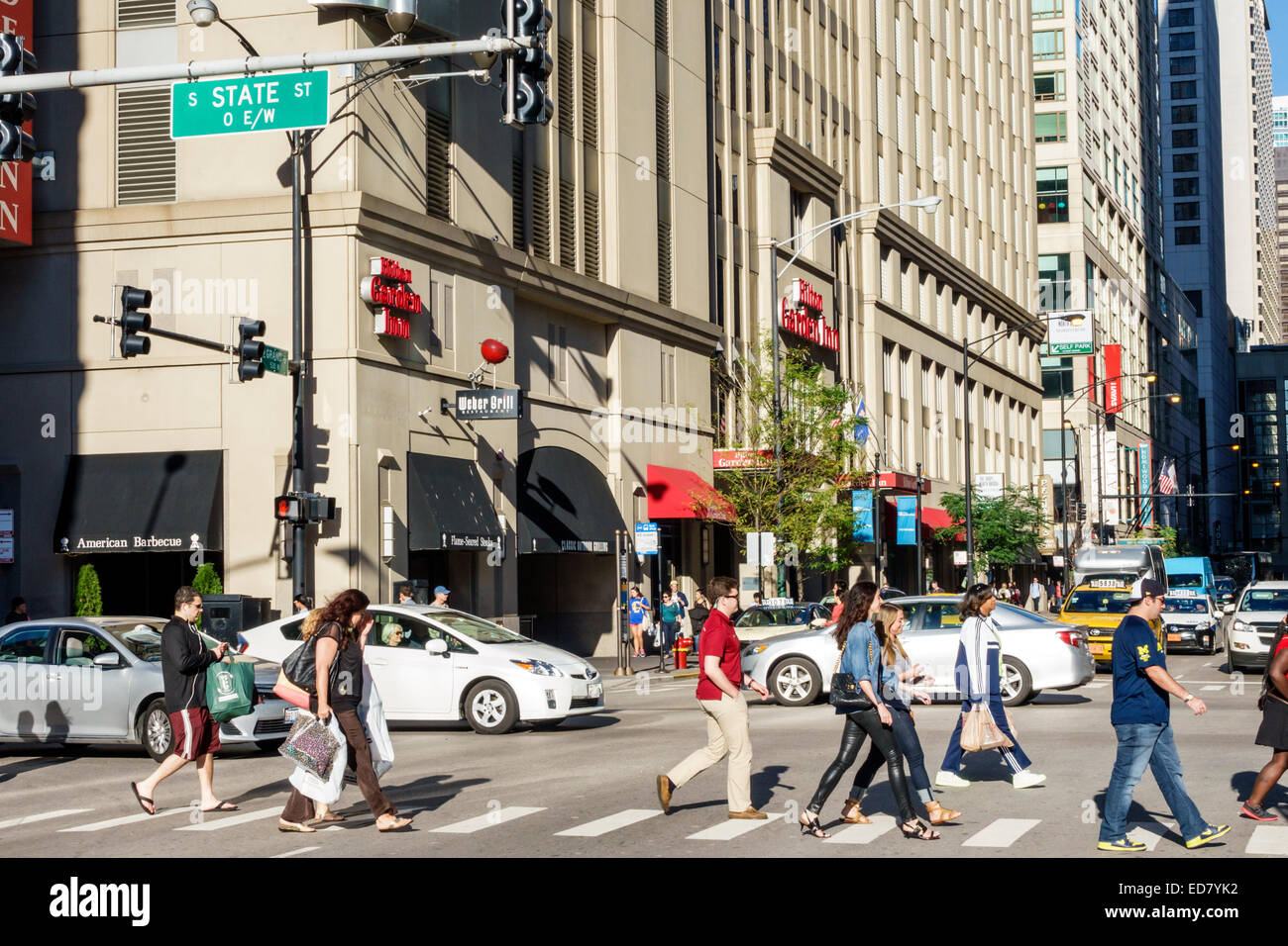 Chicago Illinois River North downtown South State Street East Grand Avenue traffic pedestrians buildings urban Hilton - Stock Image