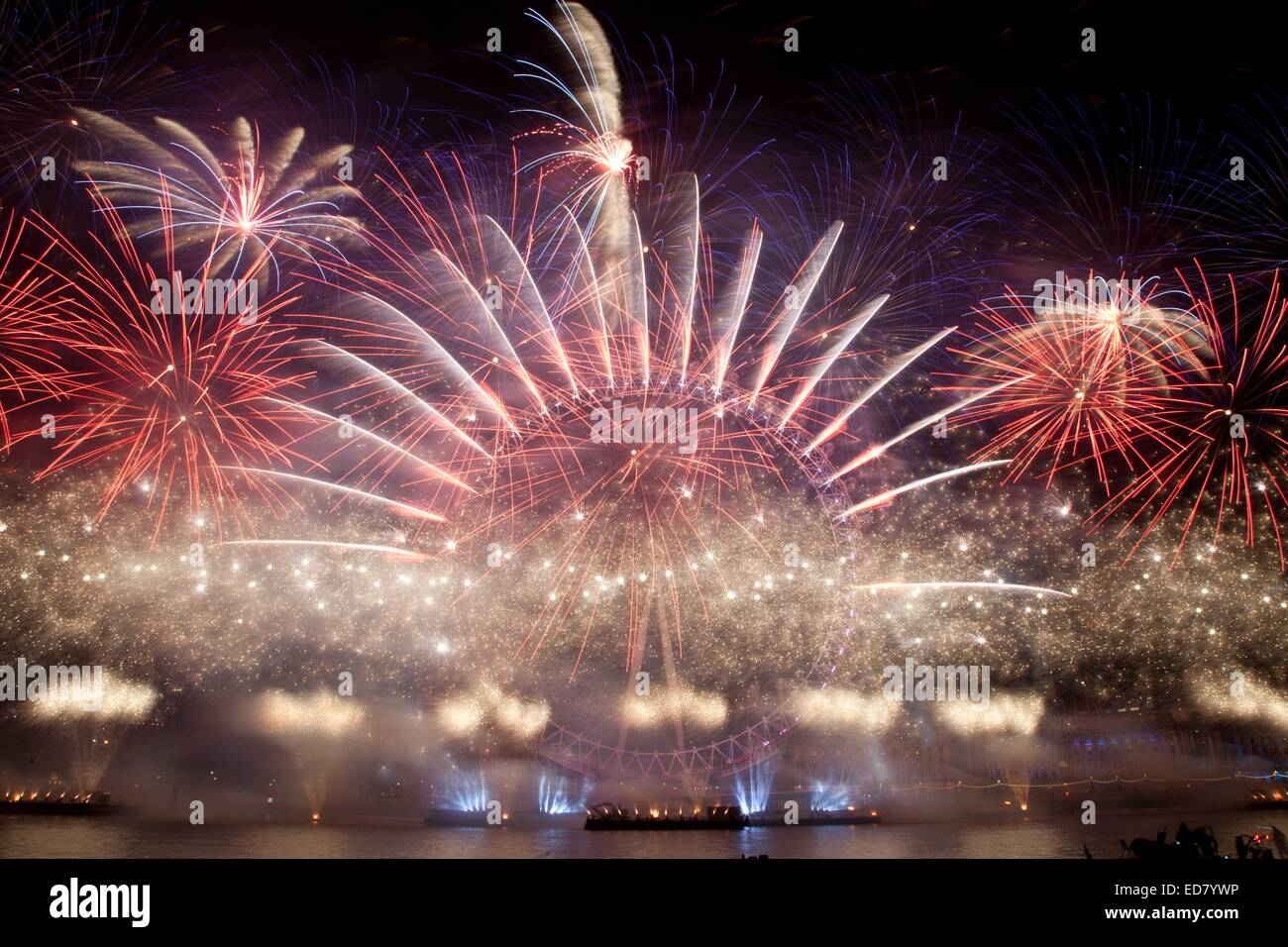 London, UK. 1st January, 2015. London welcomed in 2015 with a large fireworks display. London's NYE 2014 fireworks - Stock Image
