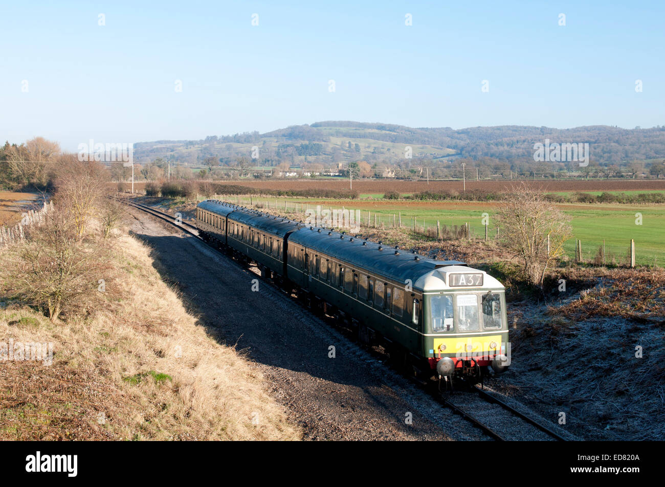 Diesel multiple-unit train on the Gloucestershire and Warwickshire Railway in winter, Hailes, Gloucestershire, UK - Stock Image
