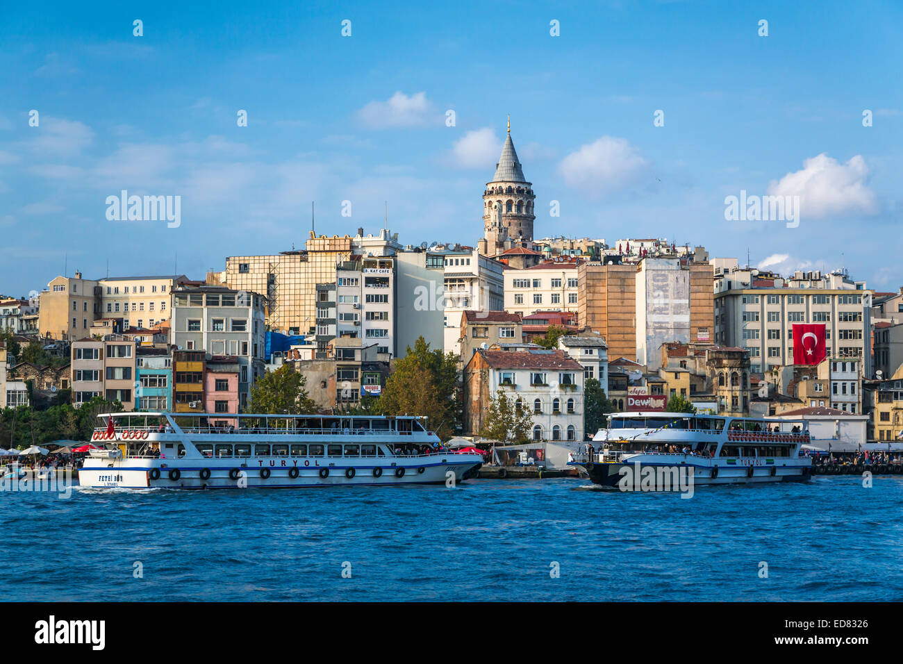Passenger ferries and water taxis in the Golden Horn waterway with the Galata Tower in Istanbul, Turkey, Eurasia. - Stock Image
