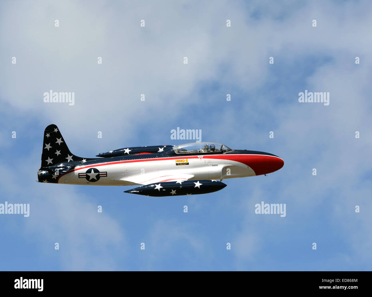 t 33 shooting star jet airplane flying high with usa flag colors