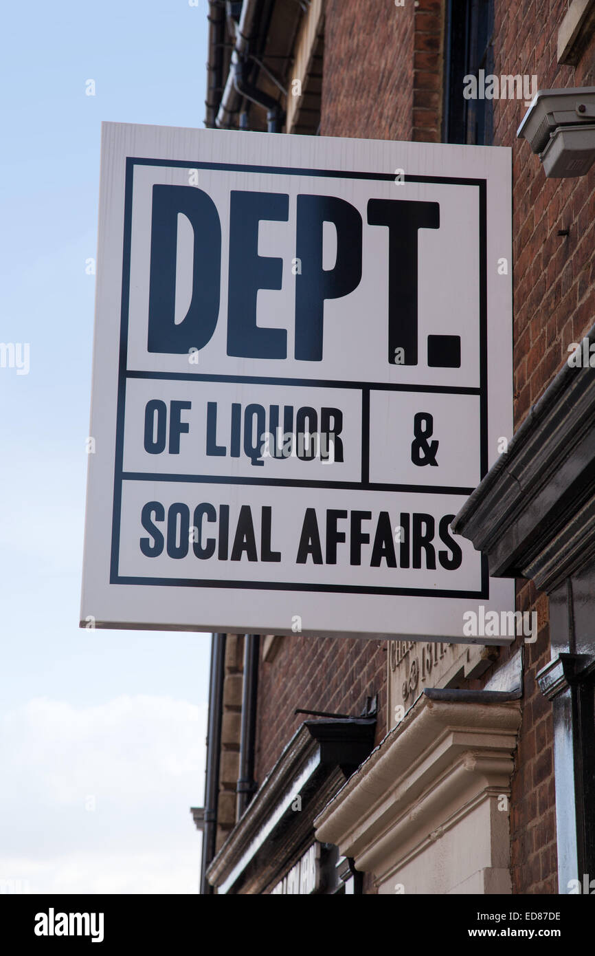 Sign saying 'Dept of Liquor and Social Affairs' outside a bar in Northampton. - Stock Image