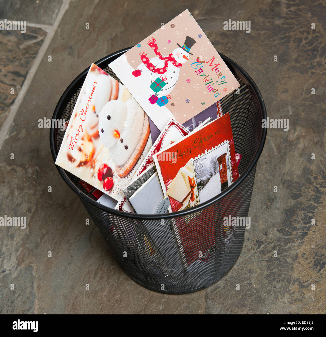 Old Christmas cards in a rubbish bin Stock Photo: 77014394 - Alamy